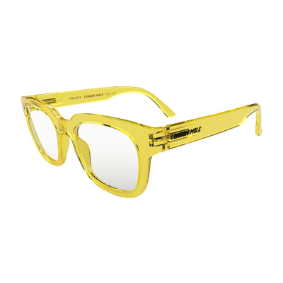 Open skew view of the London Mole Tricky Blue Blocker Glasses in Transparent Yellow