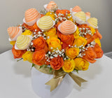 HOLLYWOOD BOX OF YELLOW AND ORANGE ROSES WITH COVERED STRAWBERRIES