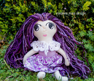Bridgett, a medium doll in shades of purple