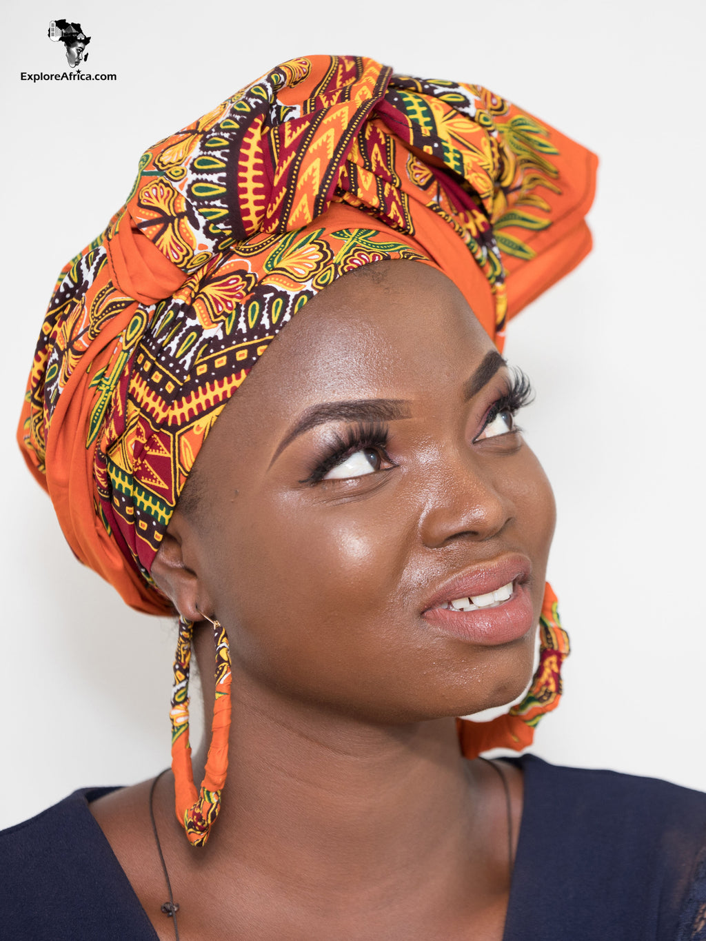 Explore African Women Head Wraps and Earrings