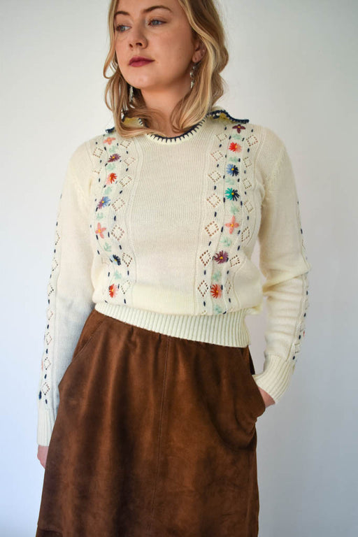 A womens small vintage wool floral cream sweater with vintage brown suede skirt