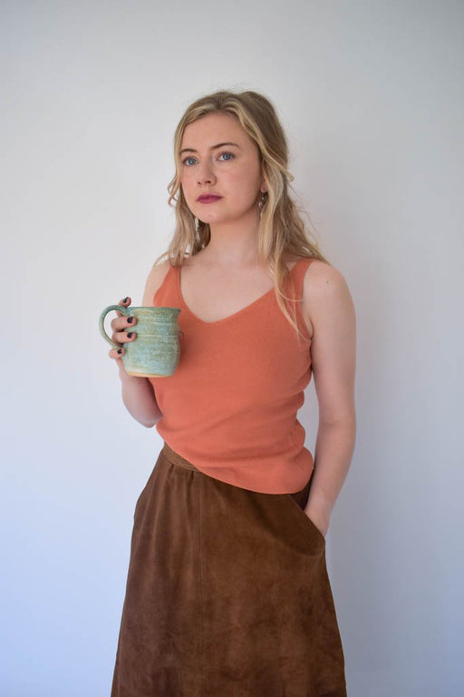 A womens medium vintage orange knit tank top with vintage brown suede skirt