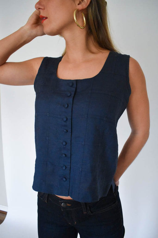 A womens medium vintage navy linen button up tank top with flare denim and gold hoops