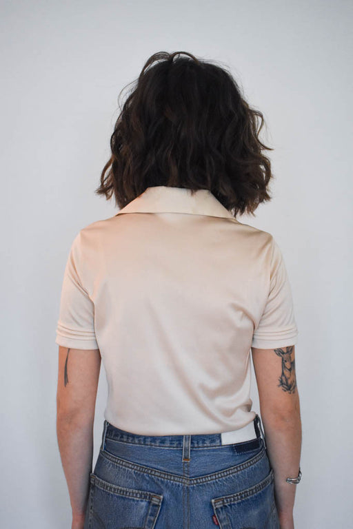 A womens small vintage cream polo shirt with vintage denim jeans