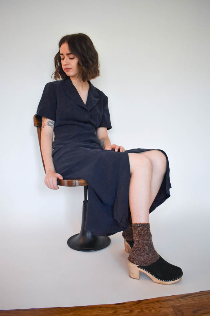 A womens small vintage navy maxi shirt dress with black clogs