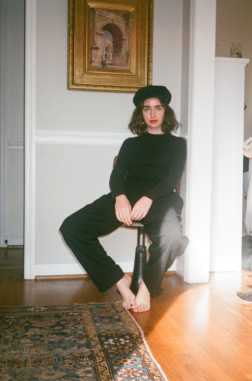 A unisex vintage black suede paperboy hat with turtleneck and red lip