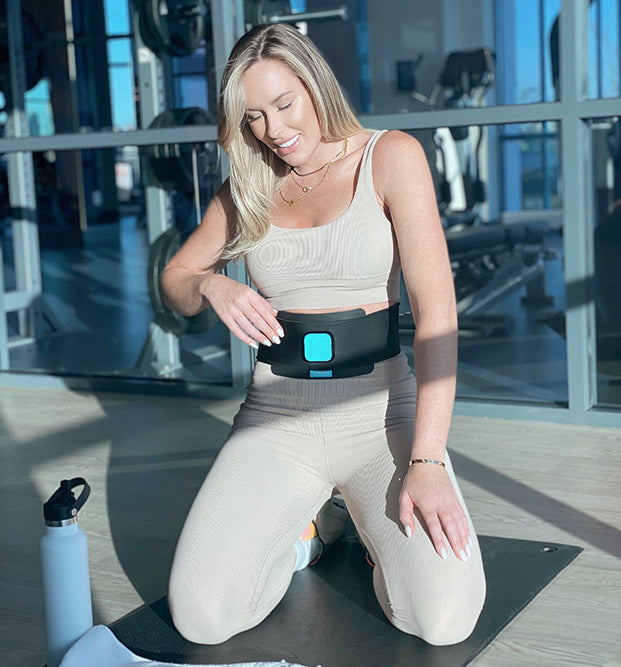 woman with ab belt