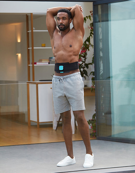 Man flexing with ab belt