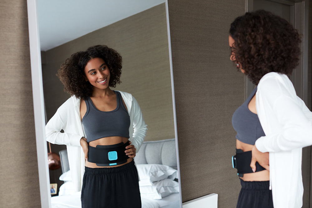 woman in mirror with ab belt