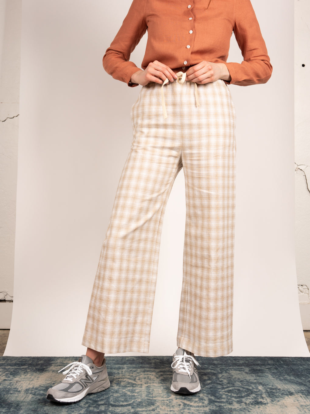 Town Clothes high waisted, wide leg, linen pant in plaid with drawstring waist.