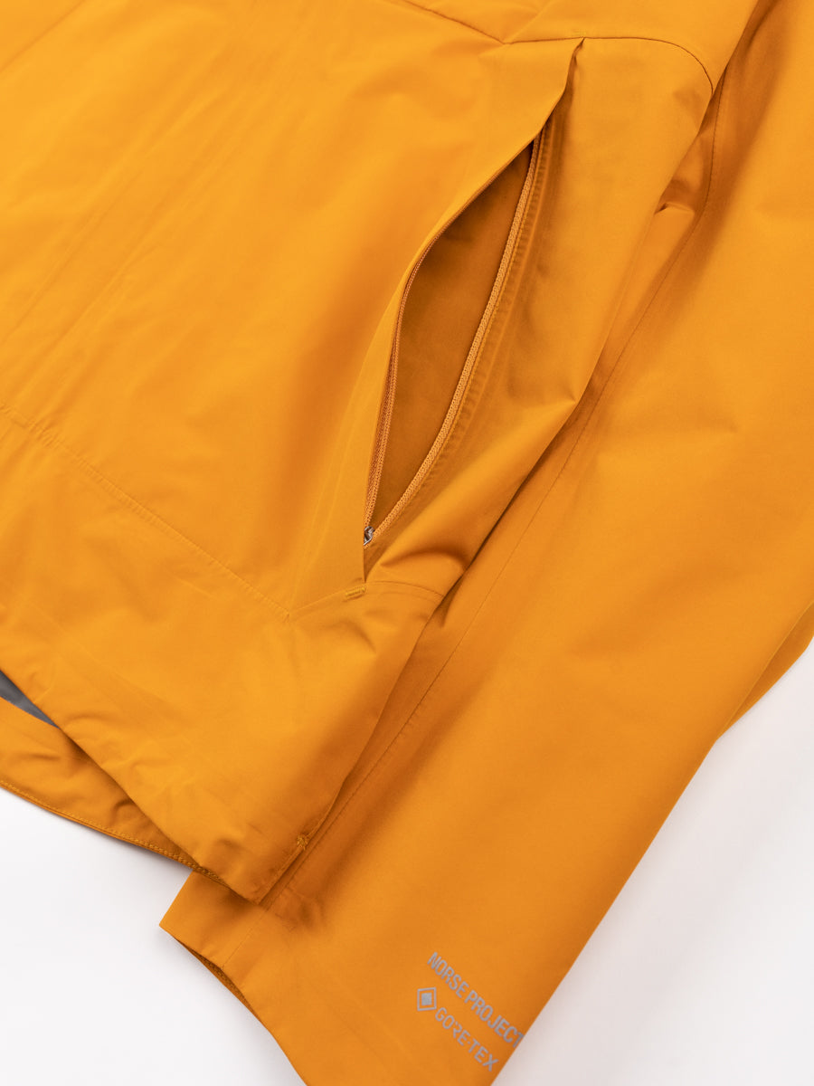Fyn shell gore tex 2.0, cadmium orange, norse projects, cuff and pocket detail
