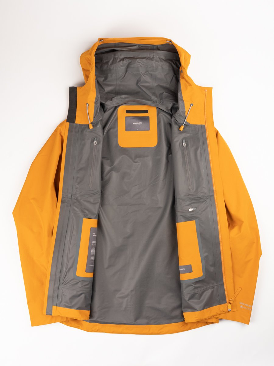 Fyn shell gore tex 2.0, cadmium orange, norse projects, interior detail