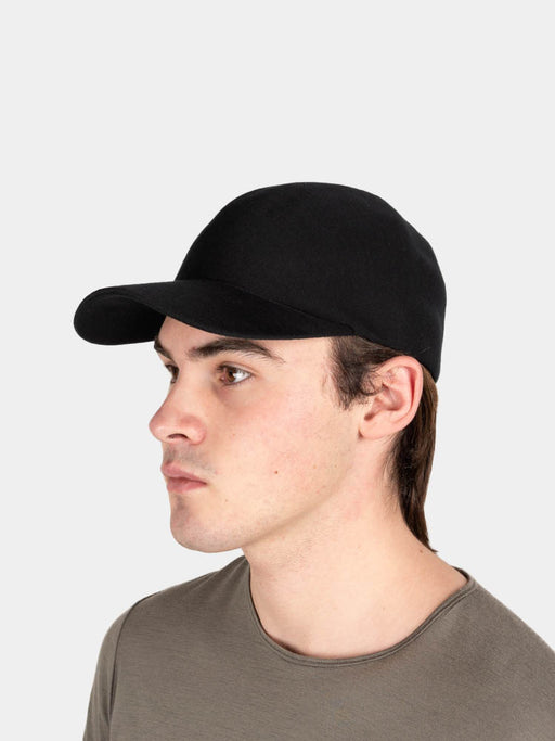 fiorm cap, black, veilance, on model
