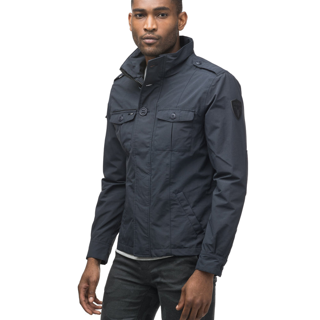 Men's waist length military style jacket in Navy. | color