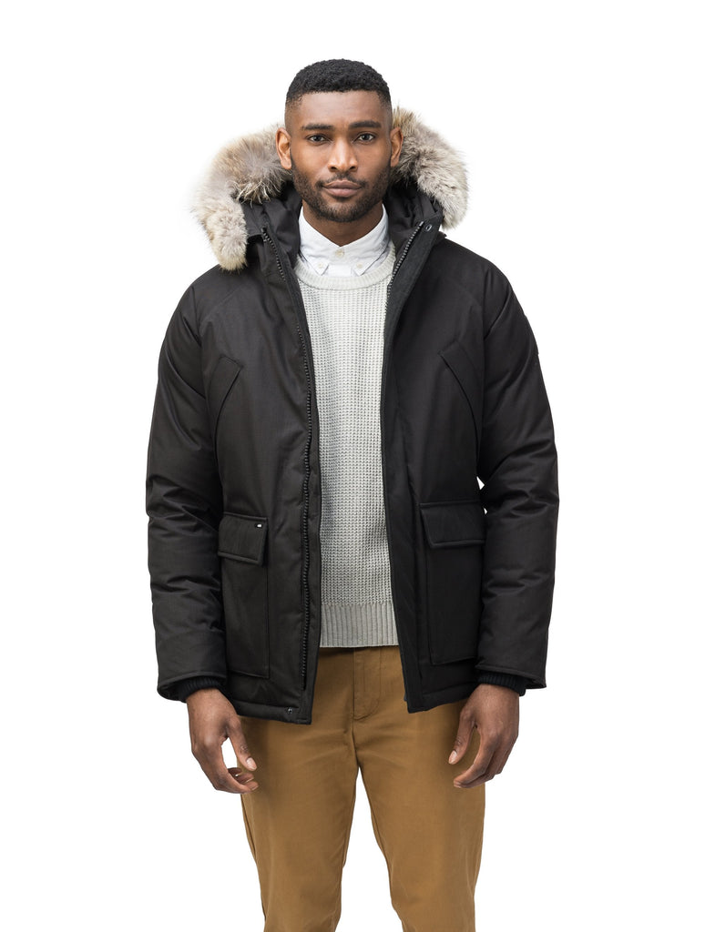 Men's waist length down filled jacket with two front pockets with magnetic closure and a removable fur trim on the hood in CH Black| color