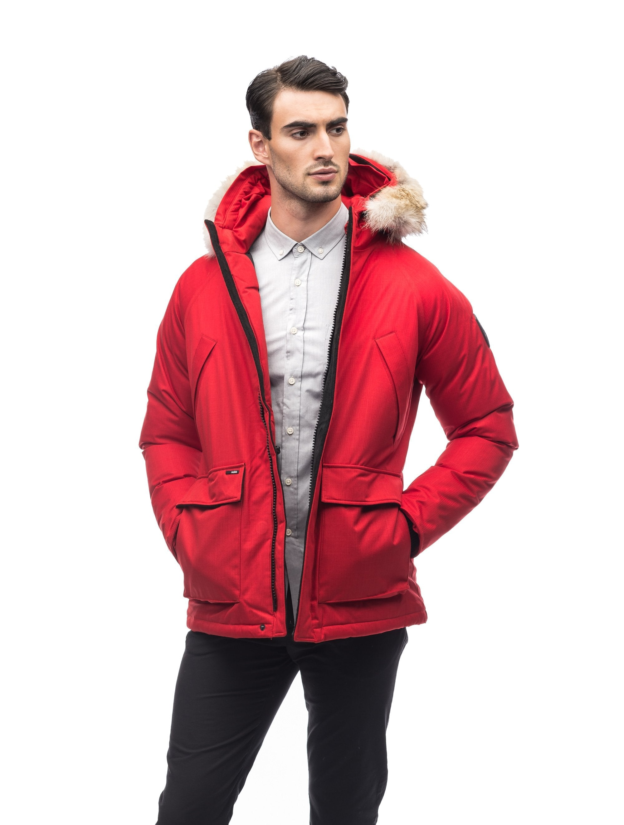 Men's waist length down filled jacket with two front pockets with magnetic closure and a removable fur trim on the hood in CH Red | color