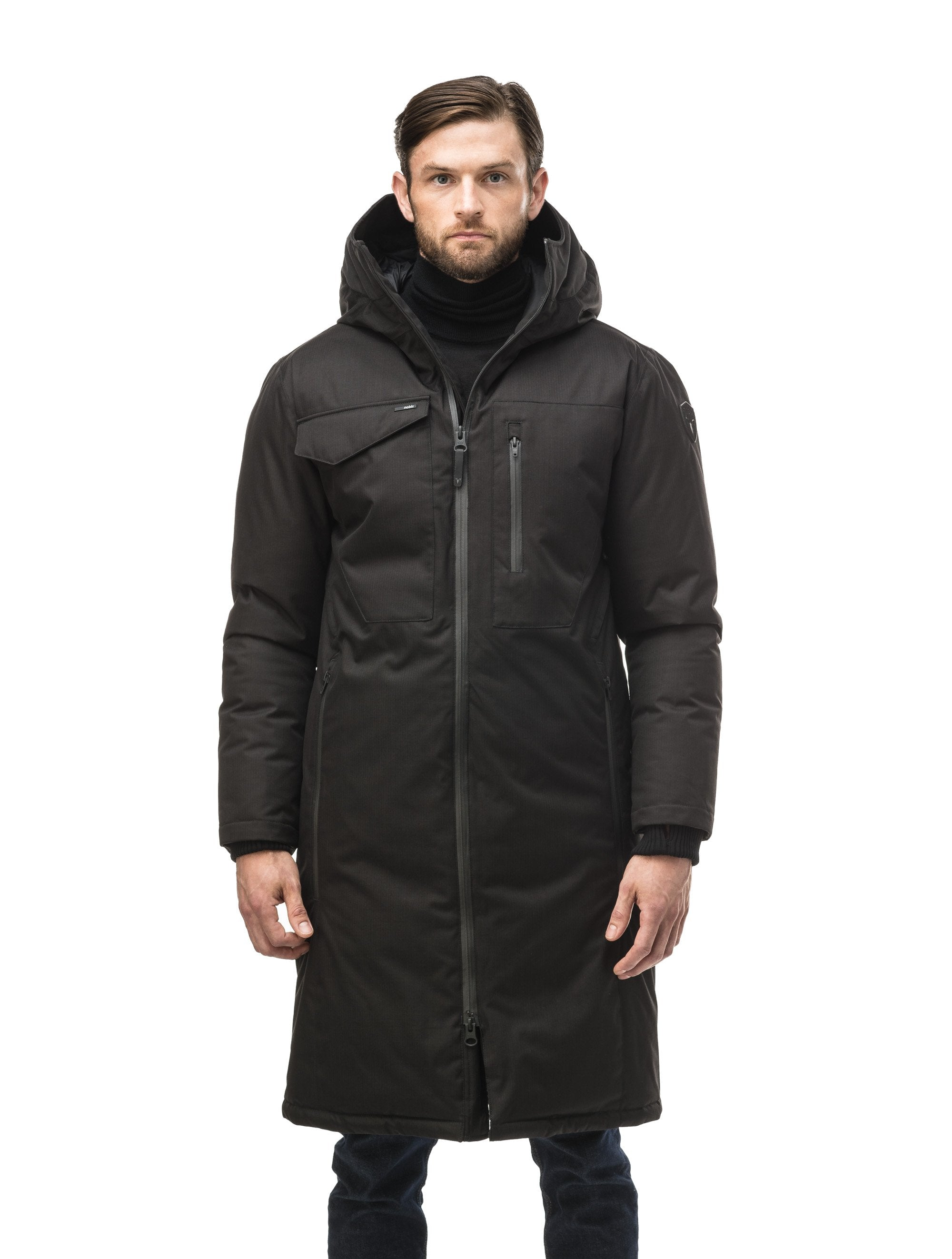 Long men's calf length parka with down fill and exposed zipper that features spacious pockets and zippered vents in Black | color