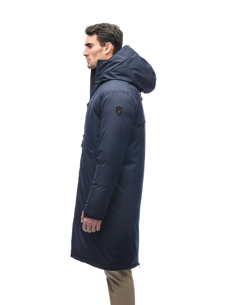 Long men's calf length parka with down fill and exposed zipper that features spacious pockets and zippered vents in Navy| color