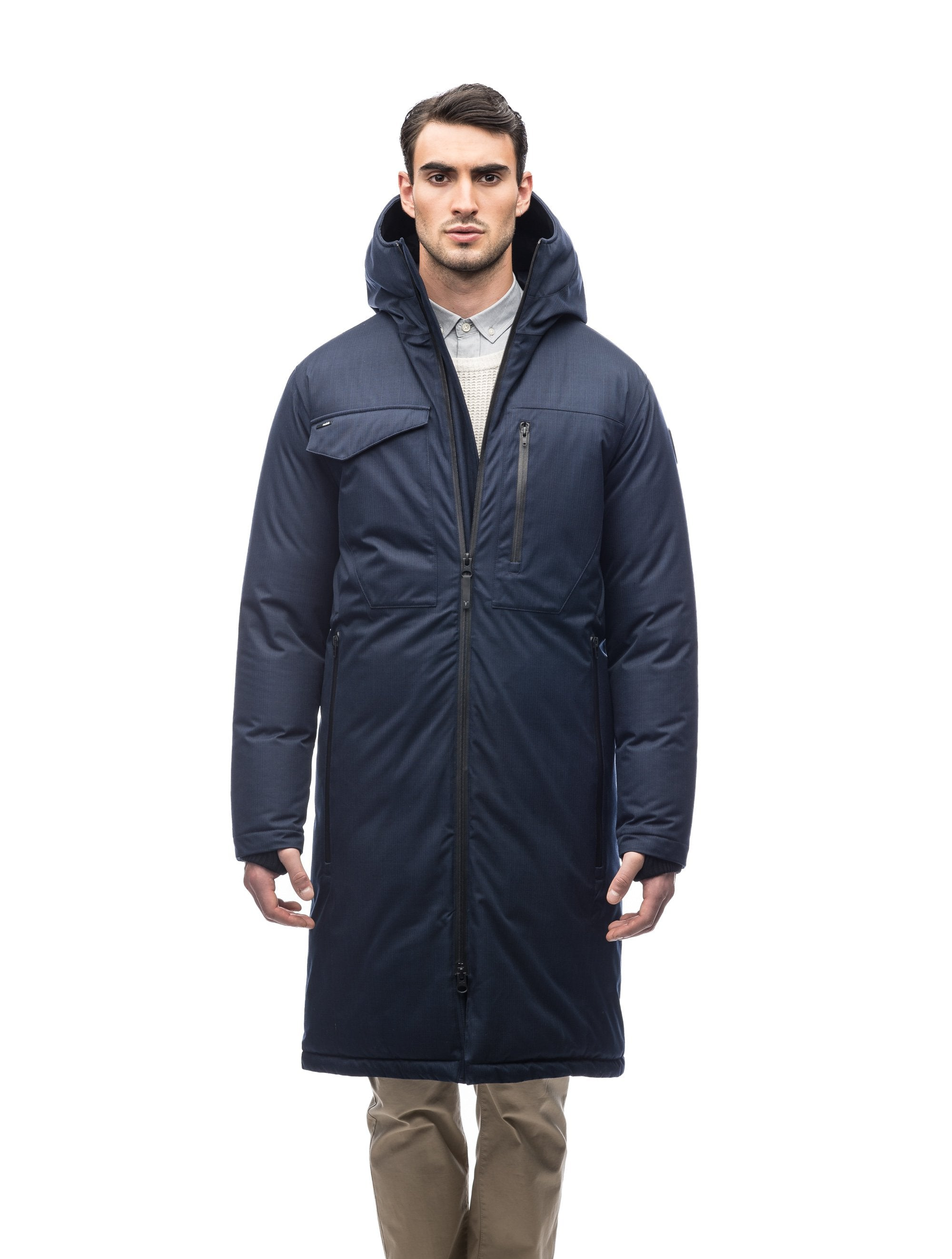 Long men's calf length parka with down fill and exposed zipper that features spacious pockets and zippered vents in Navy | color