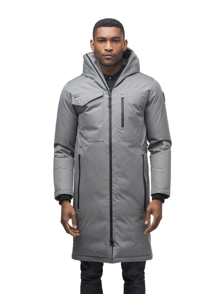 Long men's calf length parka with down fill and exposed zipper that features spacious pockets and zippered vents in Concrete| color