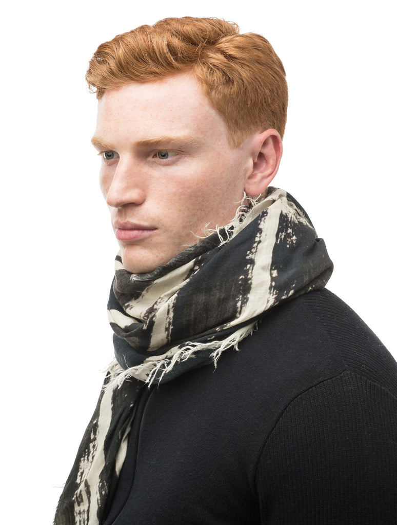 Square modal cashmere blend scarf with fringe edges in a contrast Black print.| color