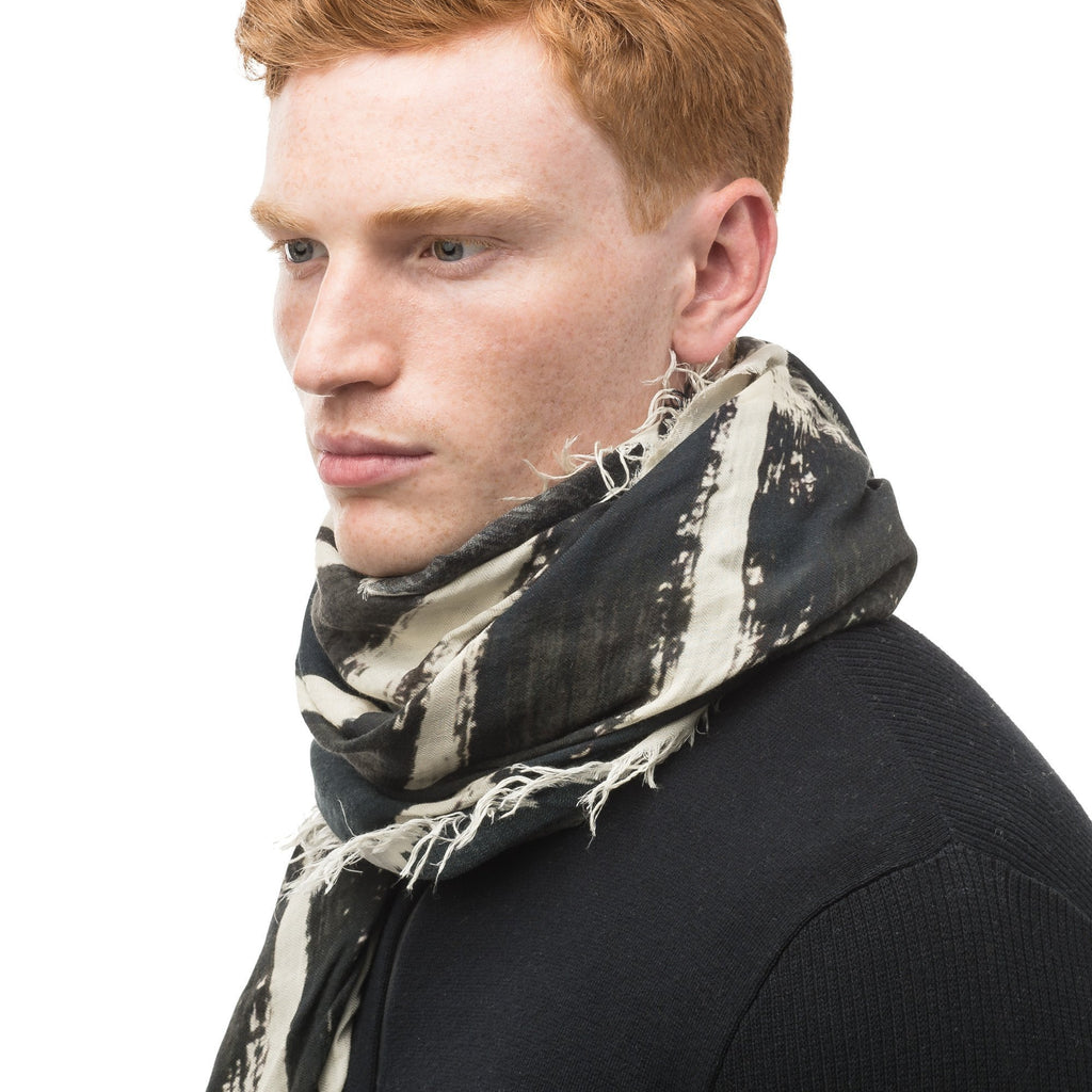Square modal cashmere blend scarf with fringe edges in a contrast Black print. | color