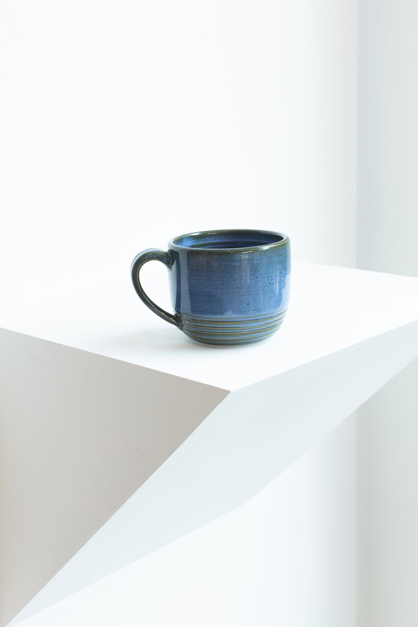 Ceramic Mug by Lina Alvarez