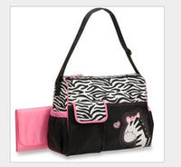 Zebra nappy bag with pink change mat