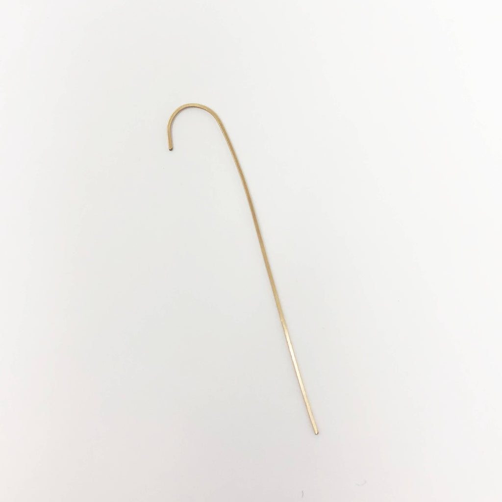 Over-the-ear, 14k gold-fill single earring spike, suggesting a sharp-edged fierceness that belies its elegant simplicity.