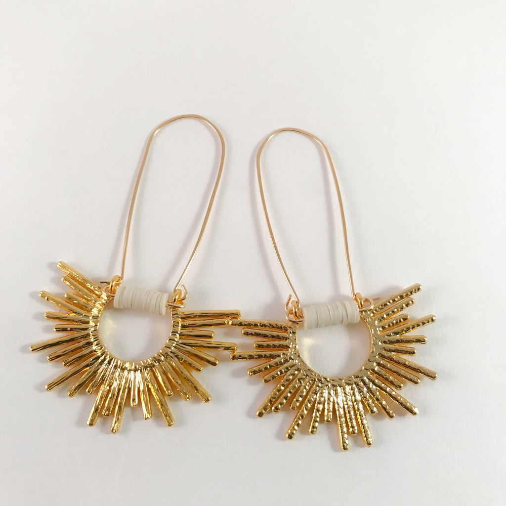 Beautiful and textured sun dangle earrings. Handmade, unique design of African vinyl disc beads with plated brass sun pendant, gold-filled ear wire.