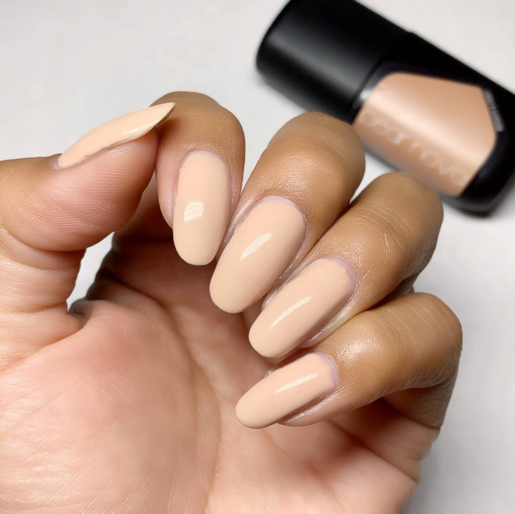 Post 21's Vegan, non-toxic, cruelty free nail lacquer in beige creme color.