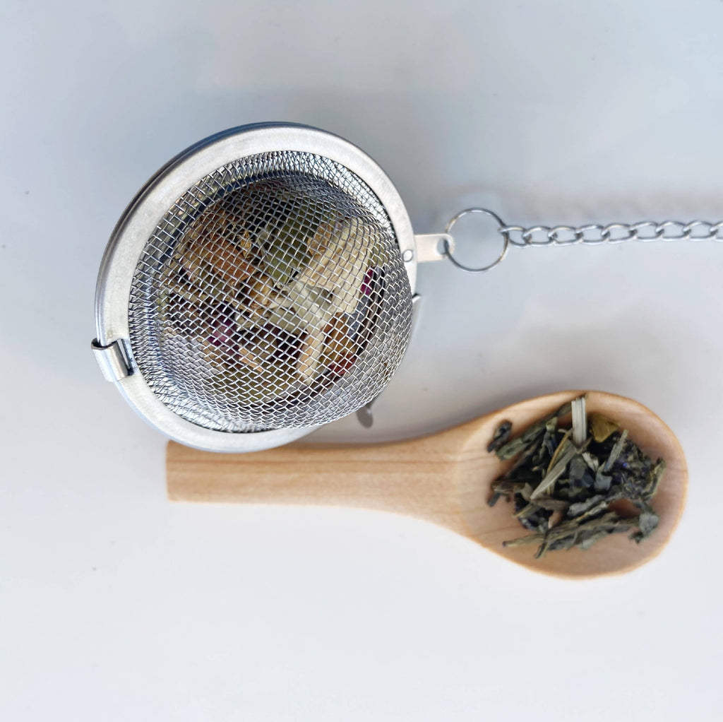 Clarity Tea Box's infuser tube kit and wooden spoon