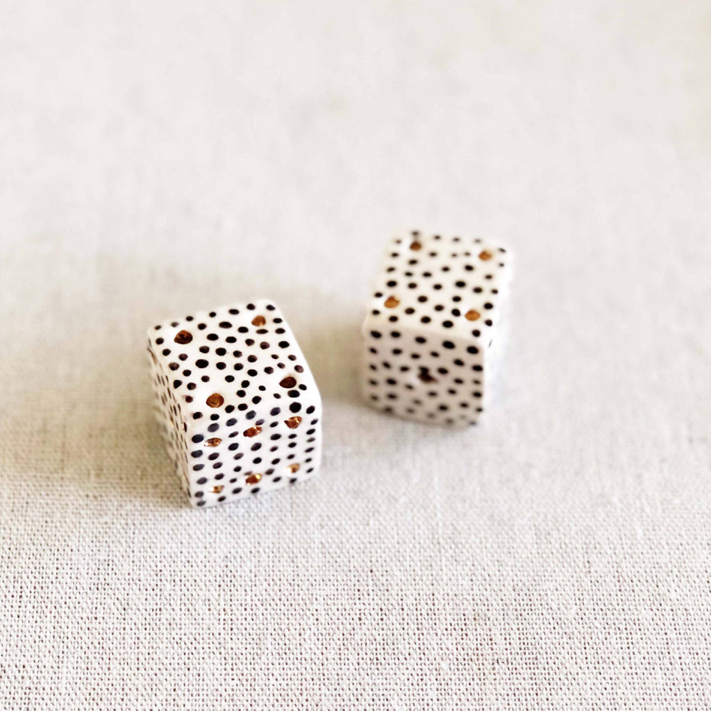 "Hand-built modern dice 1.5"" in stoneware or porcelain."