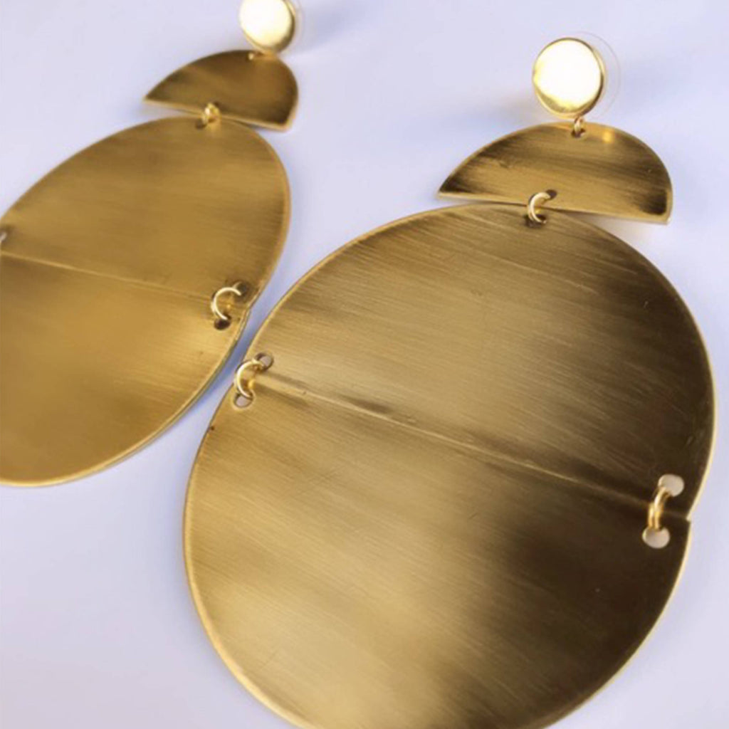 Unique geometric shaped dangled earrings. Brass half oval shape and circle design with stainless steel posts.