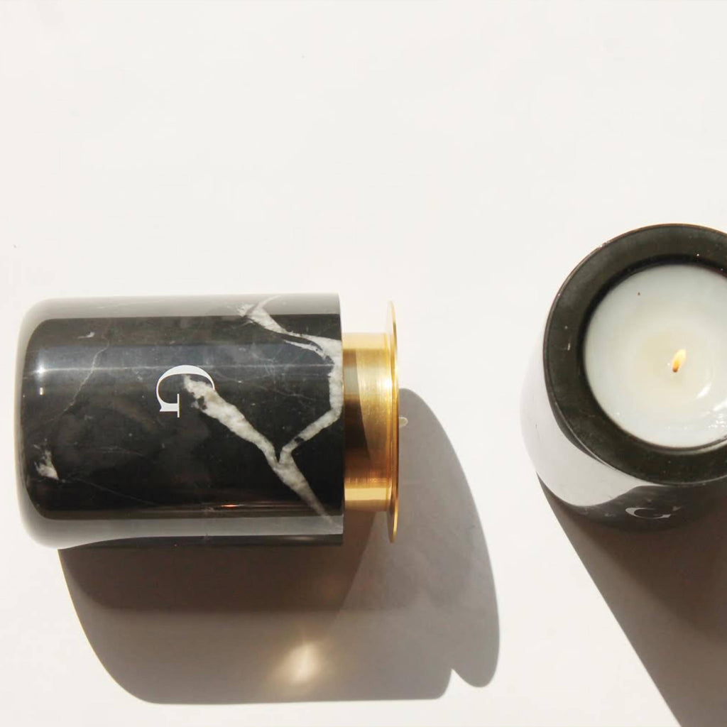 Two handmade black marble candle vessel