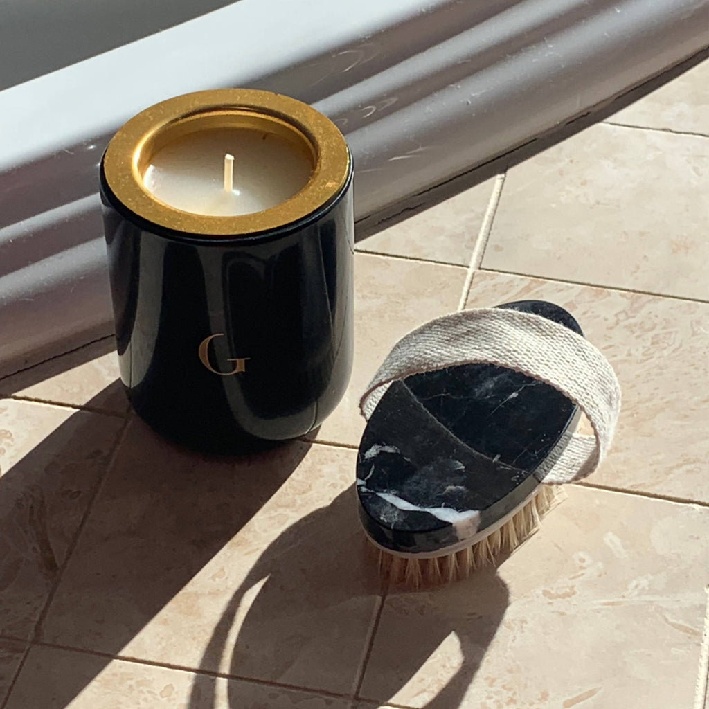 Handmade black marble dry body brush and matching black marble candle vessel.