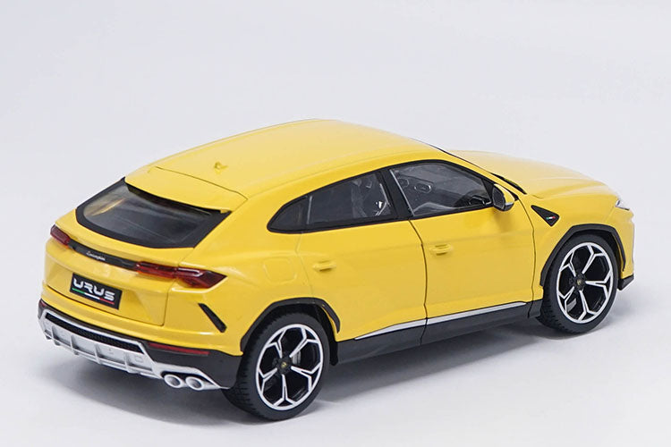 bright yellow 1:18 Lamborghini Urus SUV back passenger side