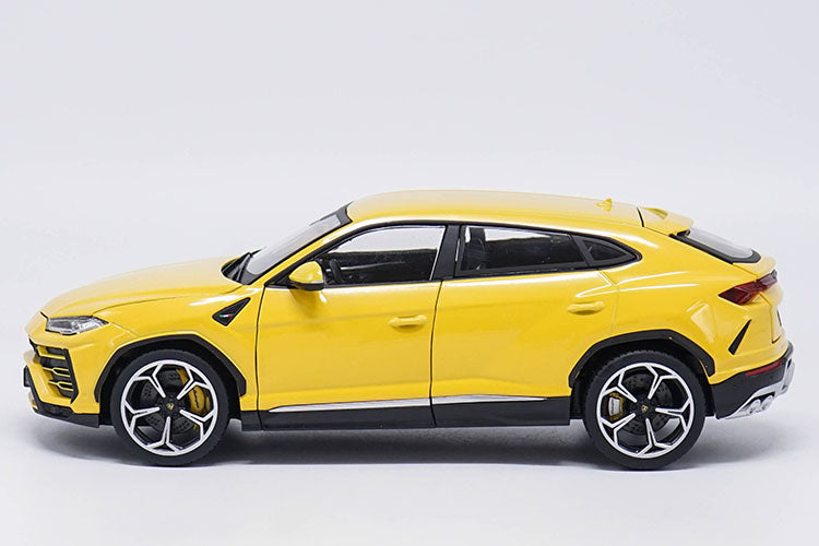 bright yellow 1:18 Lamborghini Urus SUV side driver side