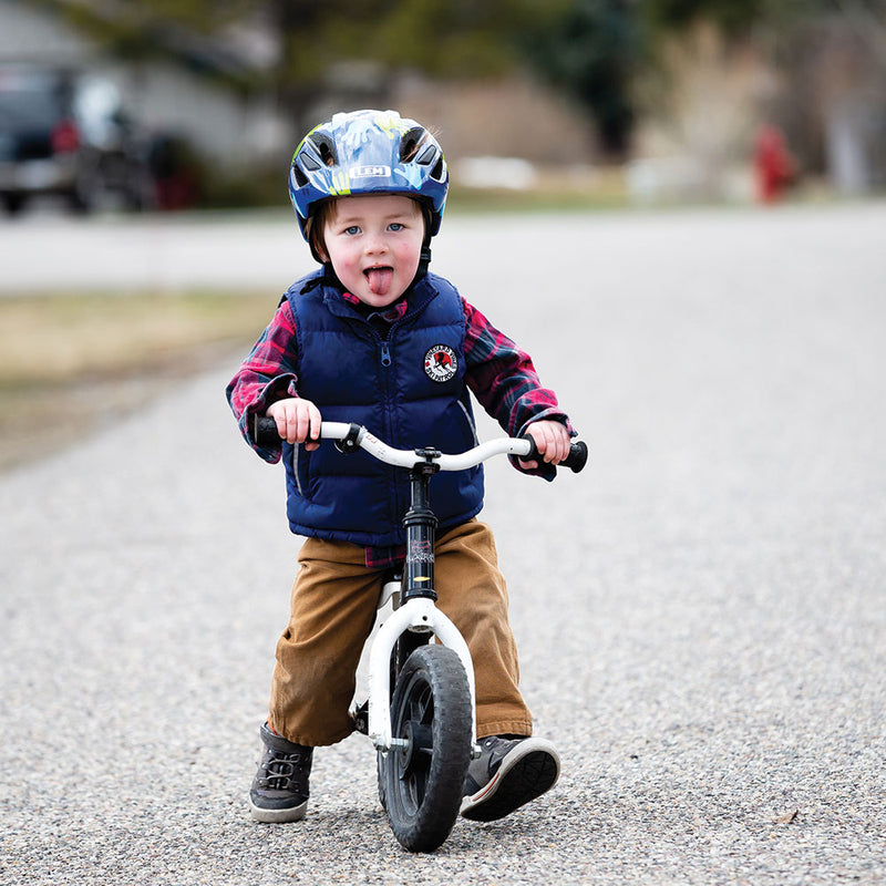 Kid riding bike in Lil Champ Toddler Bike Helmet Blue