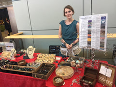girl behind jewelry counter with crystal information