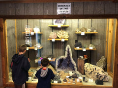 boys looking at large mineral specimens