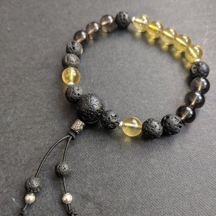 gemstone bracelet with 8 mm beads yellow citrine, smoky quartz, essential oil diffusing aromatherapy lava beads and sterling silver spacer accents