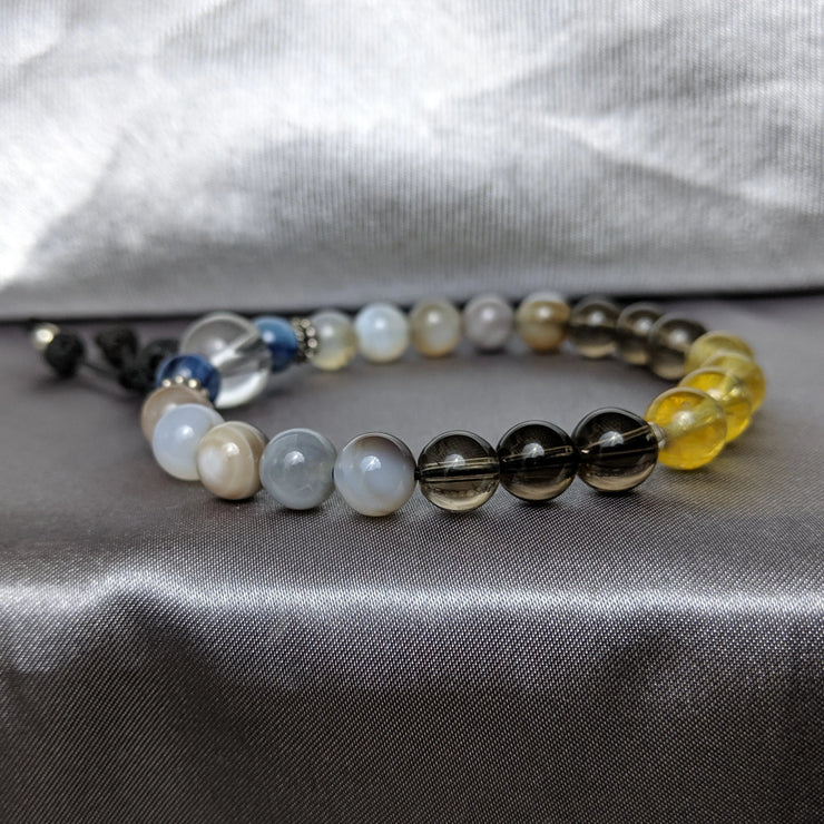 bracelet with  8mm yellow citrine, smoky quartz, Botswana agate, iridescent blue kyanite essential oil diffusing lava beads and sterling silver accents.