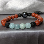 bright red jasper contrasts beautifully with high quality blue amazonite and black essential oil diffusing lava beaded bracelet