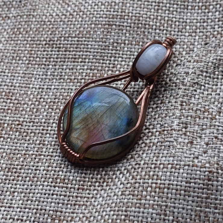 flashy rainbow moonstone and labradorite wrapped in copper wire - comes with a hemp cord