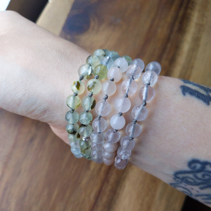 This gorgeous pastel full 108 bead mala necklace consists of the highest quality rose quartz and aquamarine as well as prehnite and moonstone, with sterling silver accents to mark the midway point at bead 54
