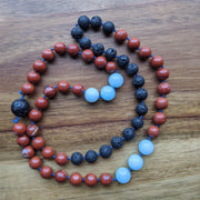 This vibrant red jasper and blue amazonite necklace includes lava stones with which you can diffuse essential oils