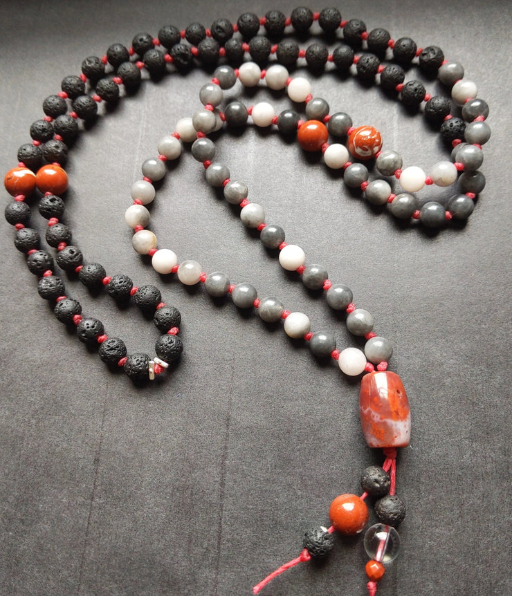 108 gemstone mala necklace : grey hawk eye / tiger eye with essential oil diffusing lava rock and red jasper hand knotted onto bright red mala cord - features 2 sterling silver spacers at the halfway point (beads 54 and 55).