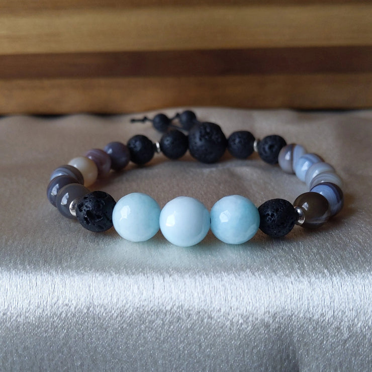 bright blue amazonite pairs beautifully with luxurious banded botswana agate, sterling silver spacers and essential oil diffusing lava beads.