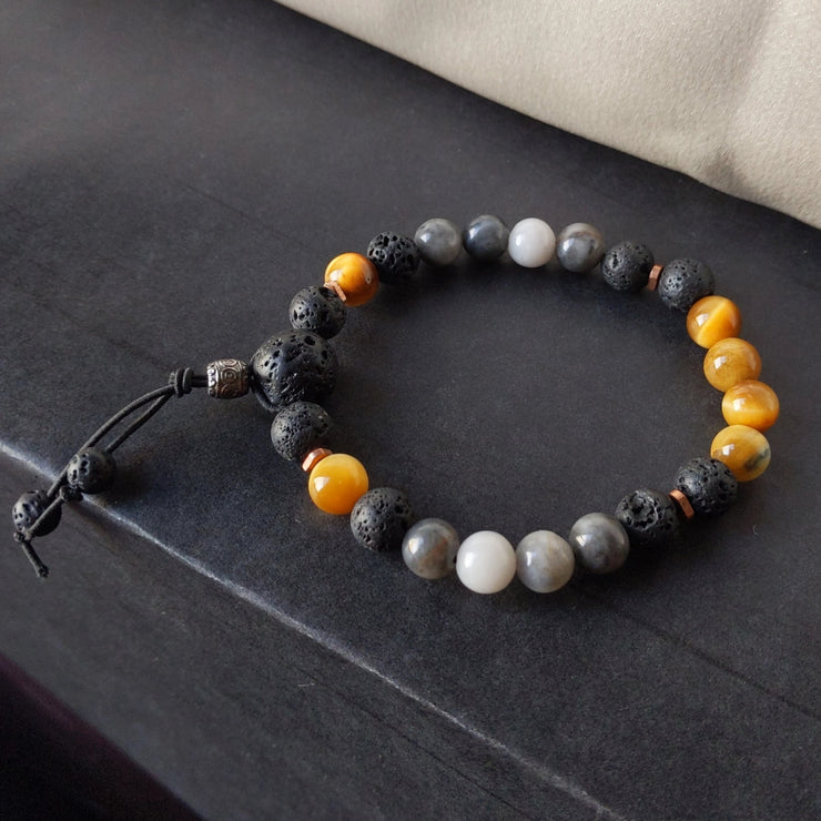 rich golden tiger eye is paired with grey hawk eye, copper spacer beads and essential oil diffusing lava rock beads.